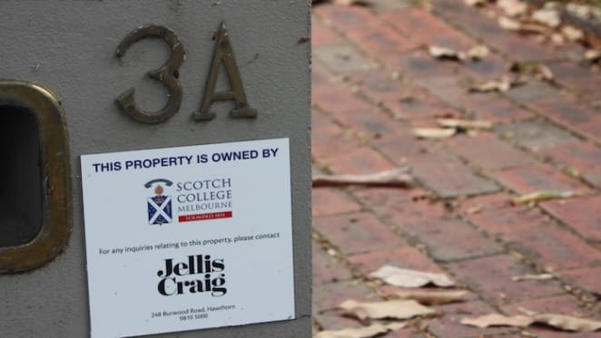 Scotch College attach ownership plaques to the many houses they own before latest Hambledon Road, Hawthorn auction