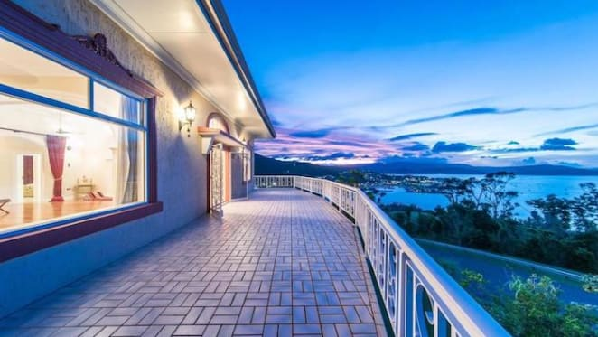 Airlie Beach home with colourful backstory hits the market