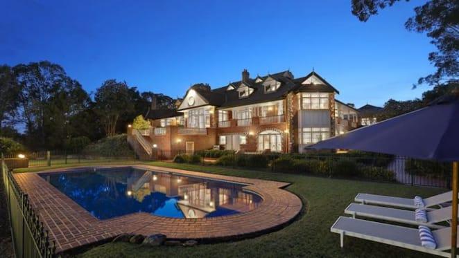 Dean Wills Belrose estate with luxury showroom garage listed