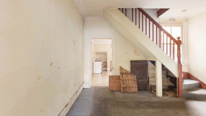 Hammered as Redfern derelict terrace sells for less