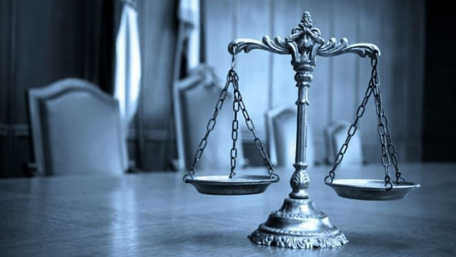 Operators of unlicensed Gold Coast financial services business charged