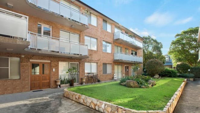 Half of Newtown apartment block for sale