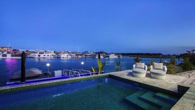 Waterfront Hope Island trophy home sold for over $5 million