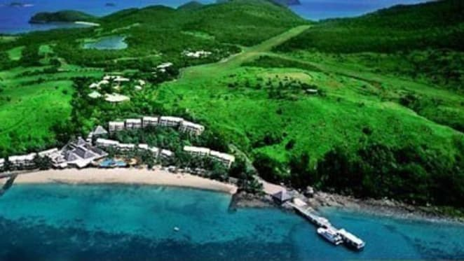 Chinese mining tycoon beats Clive Palmer to acquire Lindeman Island, with plans to redevelop