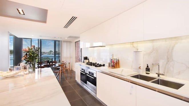 Sunland Group boss lists riverfront Newstead apartment
