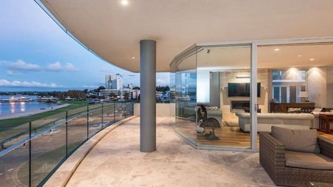 South Perth penthouse with city views listed
