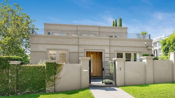 Toorak trophy home with city views listed