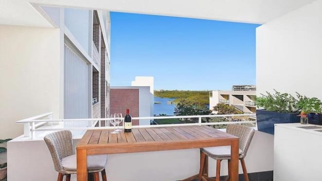 Bachelor contestant Bec Chin and Dean Vicelich sell at Wentworth Point