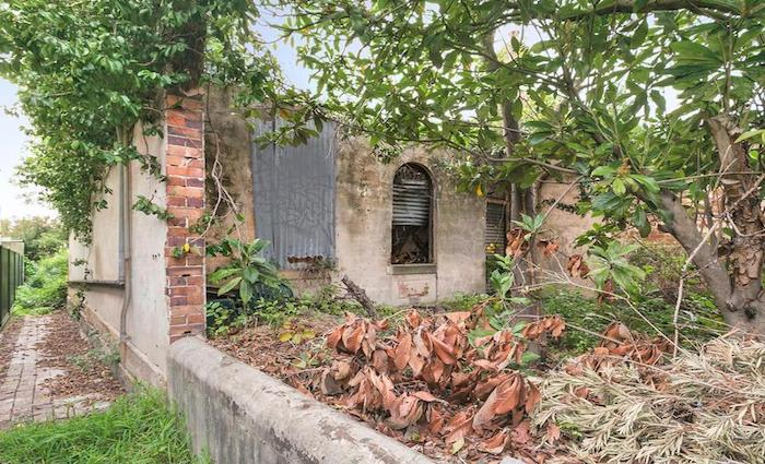 Overgrown Enmore former boarding house sold for less than expected