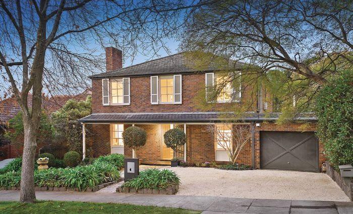 Former AFL coach Brad Scott buys Kooyong family home