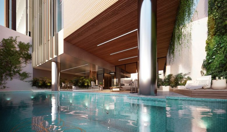 The Evermore outdoor pool and outdoor cabana and lounge area.