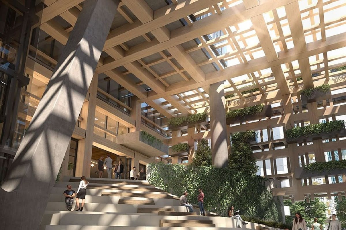 Yarra One features a timber clad public atrium and integrated planter beds.