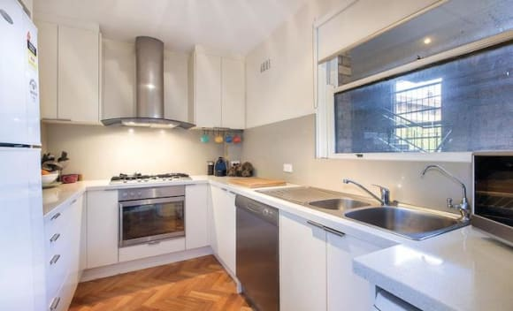 Old-style two bedroom Sheridan Close, Melbourne apartment sold