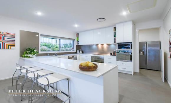 Hughes home sells for <img src=