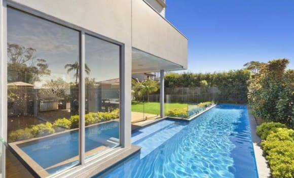 House Rules presenter Joh Griggs sells at Collaroy