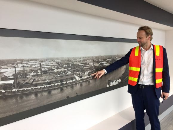 Jeremy pointing out one of the selected artworks displayed on level 41