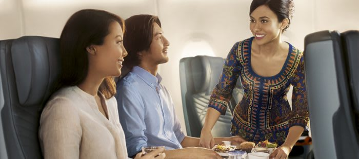 Singapore Airlines cabin crew serving passengers