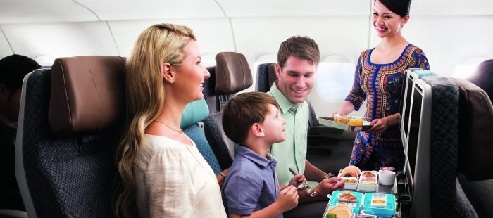 Singapore Airlines cabin crew serving a family
