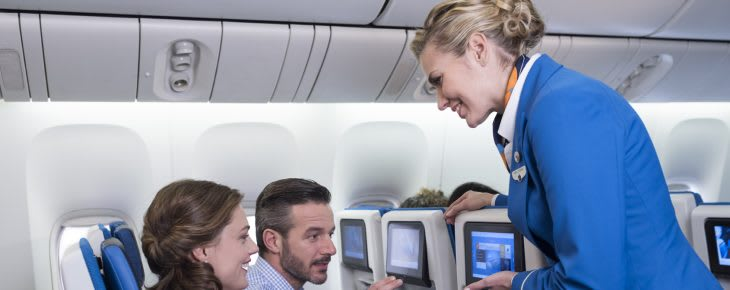 Air hostess serving passenger in Economy comfort KLM