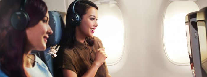 Singapore Airlines girl watching tv screen
