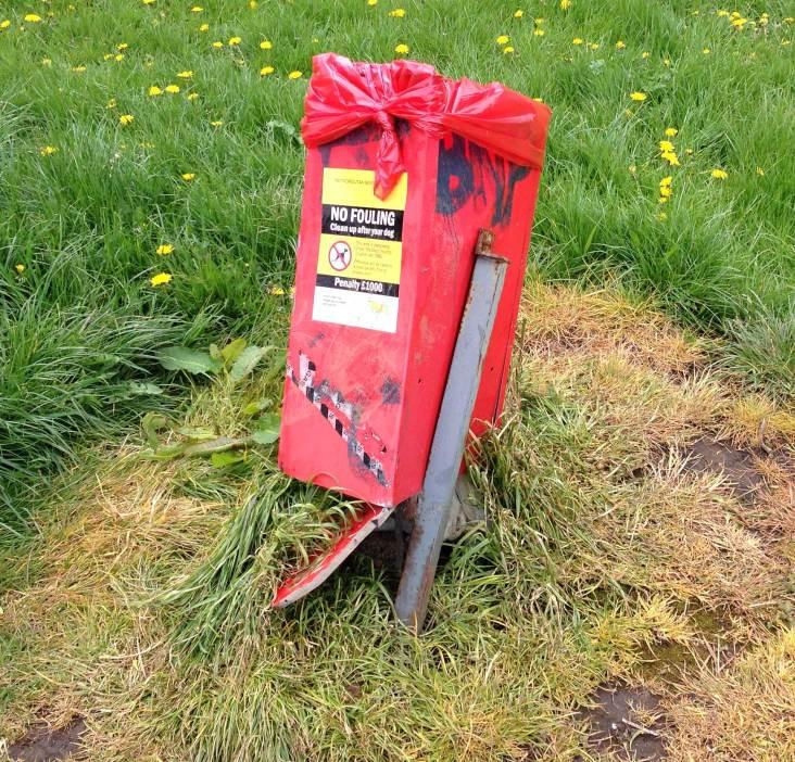 The vandalised bin in Sunny Bank Wood, daubed with offensive graffiti.