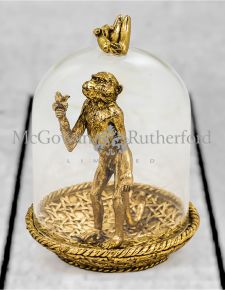 Golden Hungry Monkey in Glass Dome