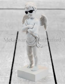 "White ""Too Cool"" Cherub Figure on Base"