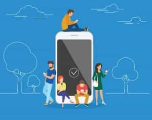 Vector graphic of young people using smartphones, sitting and standing on and around a giant smartphone.