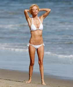 **EXCLUSIVE** Jenna Jameson poses playfully for a photo shoot with her beloved dog in Malibu