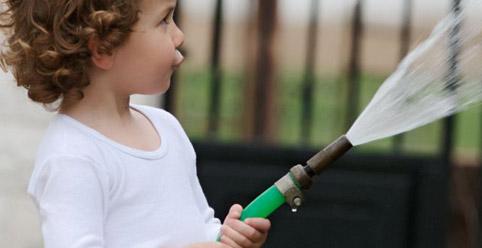 girl spraying water