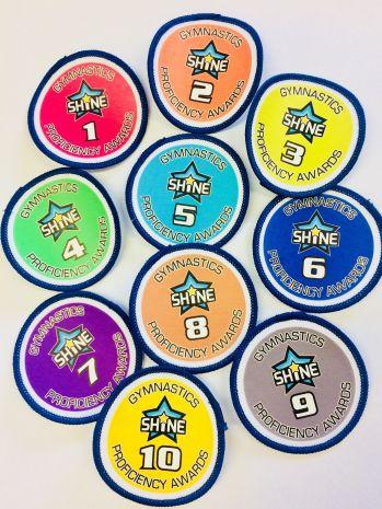 Shine Gymnastics Proficiency Award badges