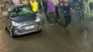 Car rams into procession