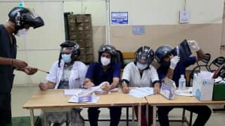 Doctors wearing helmets