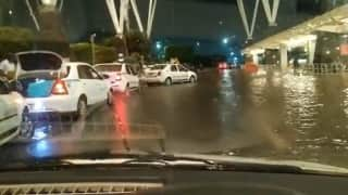 Watch: People take tractor rides to Bengaluru airport as rains flood roads