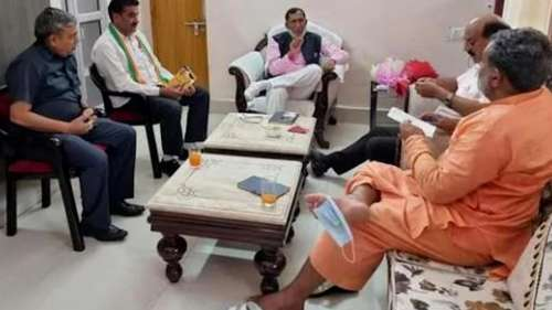 Viral: Uttarakhand minister's photo shows mask hanging off his toe