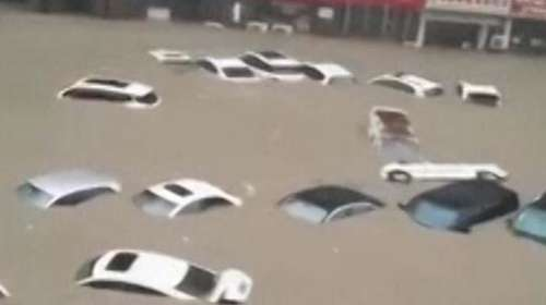 China floods: Thousands evacuated, train stations and roads inundated