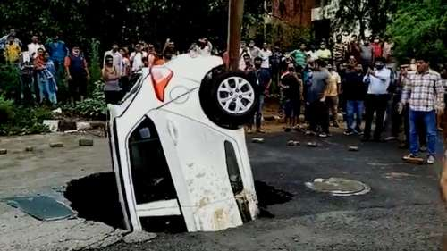 Watch: Pothole swallows car in Delhi after rain, pulled out by crane