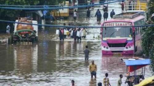 Heavy rains batter Mumbai, rail tracks flooded, passenger trains stranded