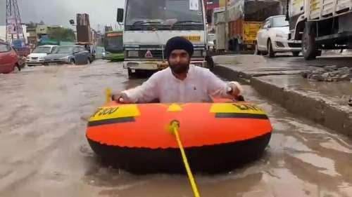 Video: BJP leader rows raft on waterlogged Delhi road, takes a dig at CM Kejriwal