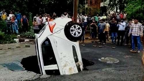 Pothole swallows car