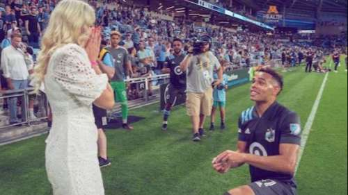 I do! Footballer's on-field proposal for marriage in front of thousands of fans
