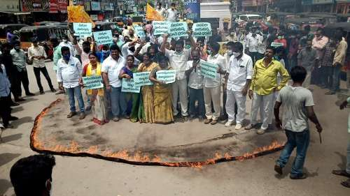 Watch: TDP workers stand in the ring of fire protesting against price rise