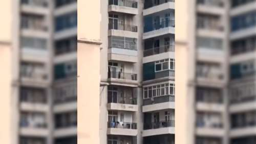 On video: Man tries to save wife hanging from 9th floor, she falls