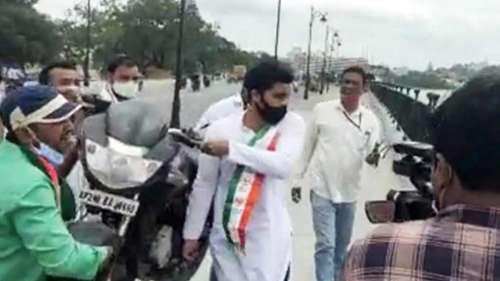 Congress workers throw bike into Hyderabad lake to protest fuel prices