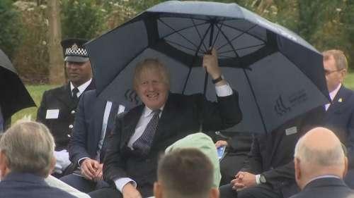 Watch: UK PM Johnson struggles with his umbrella, Prince Charles amused