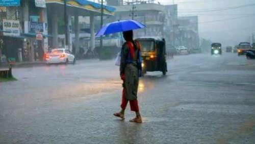 Mumbai rain: streets waterlogged, train services hit, buses diverted