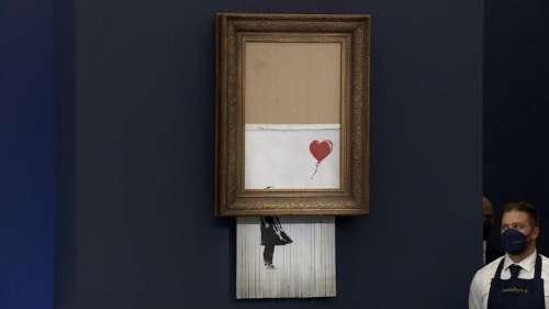 Shredded Banksy artwork sells for $25.4 million at Sotheby's auction in London