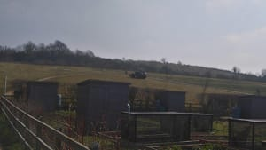 Paul Brunton, from Ed's Garden Maintenance, uses a tractor to mow the grass in Bristol