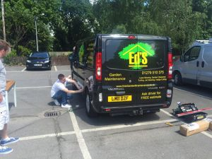 Dan's Branding His Van with Ed's Garden Maintenance