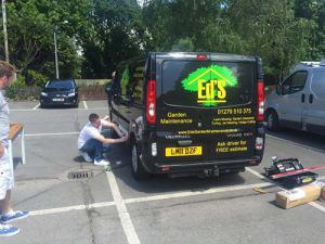 Dan's Branding His Van with Ed's Garden Maintenance
